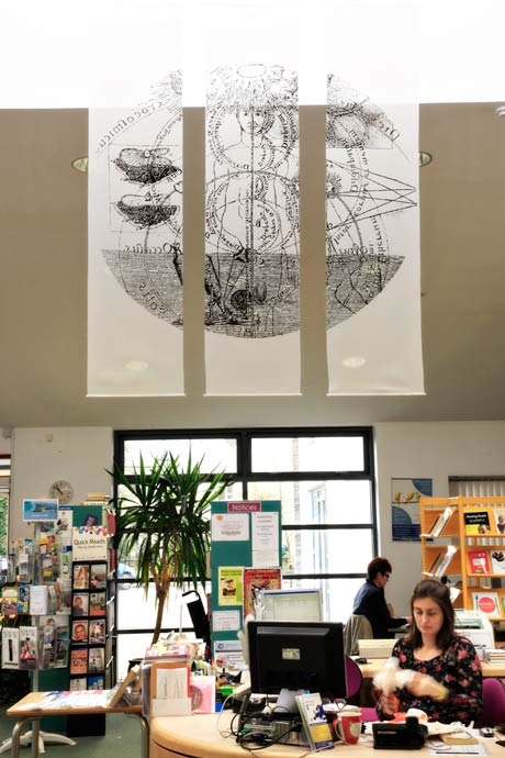 photo of the Enlightment wall hanging in the library