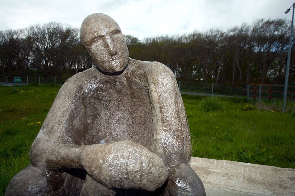 photo of seated figure